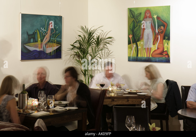England UK Newcastle Upon Tyne The Biscuit Factory Restaurant Dining Tables Paintings