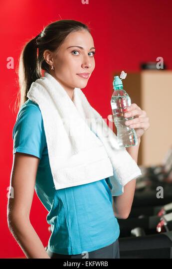 Teen girl drinking water gym stock photos teen girl drinking woman at the gym drinking water stock image sciox Gallery