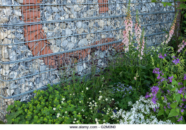 Decorative Brick And Flint Wall Contained Within Steel Gabion Cages. Brewin  Dolphin Garden Chelsea Flower