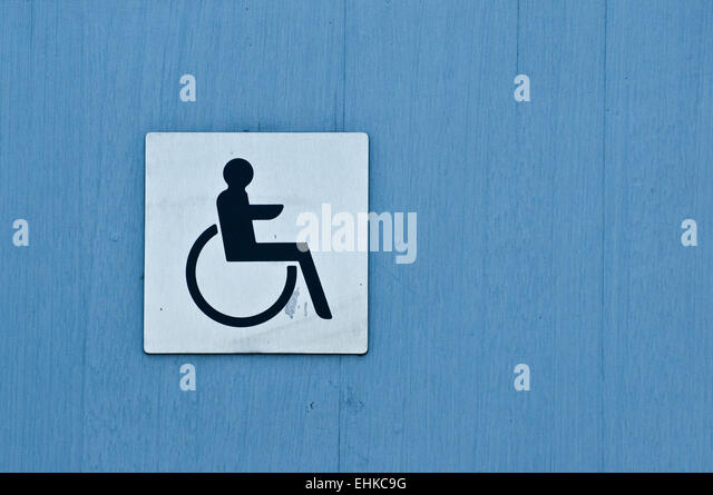 Disabled Sign On The Door Of A Public Toilet