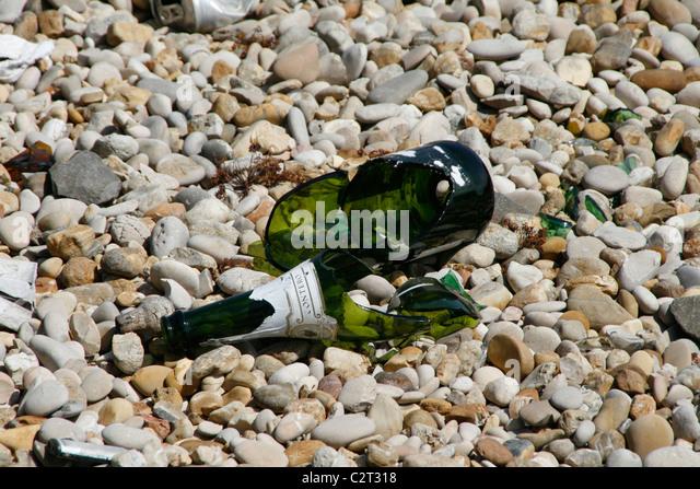 broken bottle on floor ground in sun - Stock Image