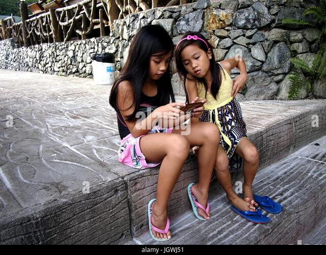 Filipino girls stock photos filipino girls stock images alamy antipolo city philippines july 7 2017 young girls play a video game altavistaventures Choice Image