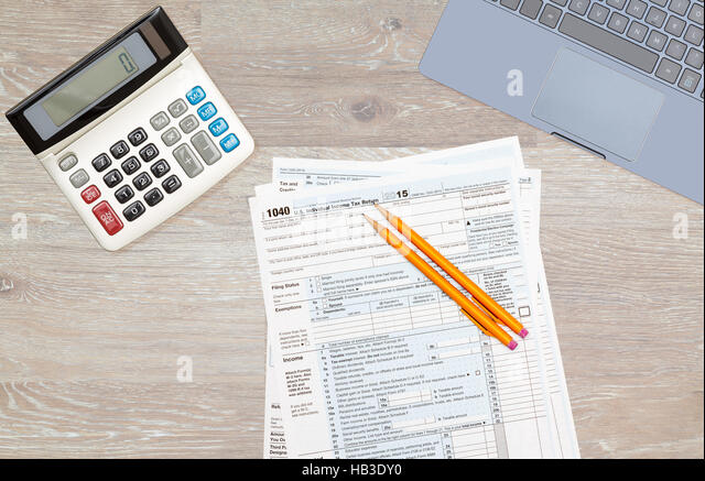 1040 tax computer stock photos 1040 tax computer stock for 1040 tax table calculator