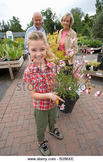 Do it yourself centre stock photos do it yourself centre stock senior couple and granddaughter 8 10 in garden centre portrait stock solutioingenieria Choice Image