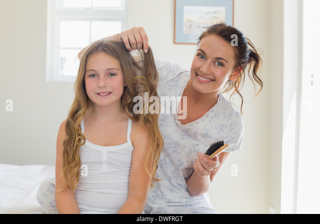 mother combing stock photos mother combing stock images. Black Bedroom Furniture Sets. Home Design Ideas