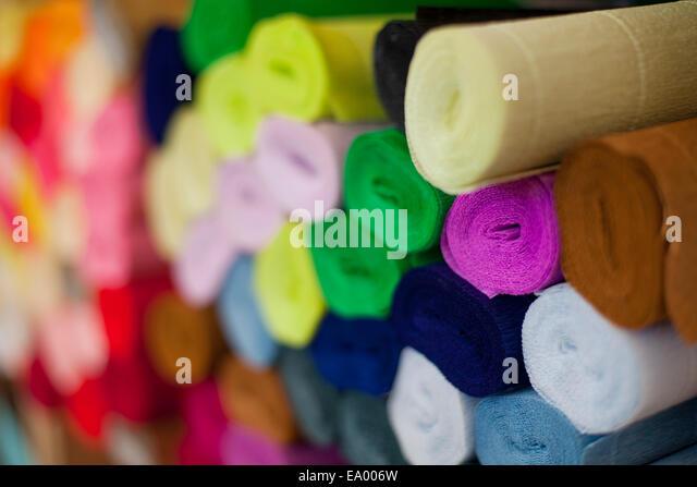still life of multi colored crepe paper rolls stock image