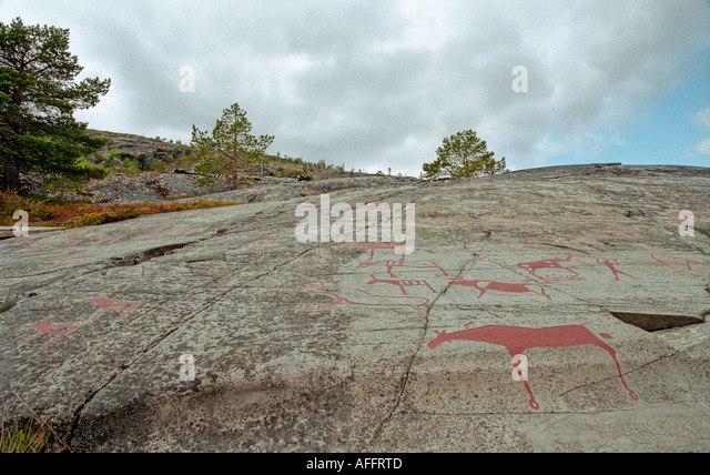 The rock carvings at alta stock photos
