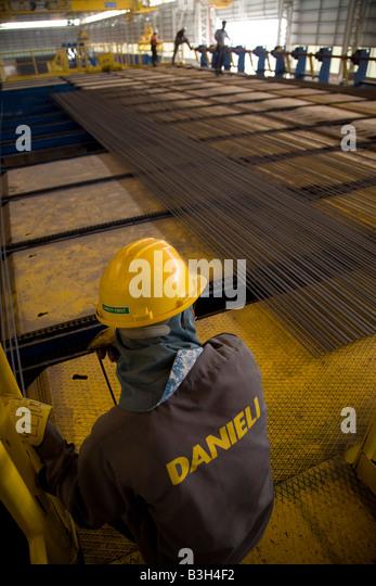 worker checking rebar steel rods on production line at eisf steel plant abu dhabi united arab rebar worker