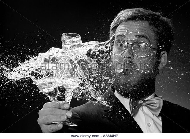 MR MAN HOLDING AN EXPLOSING GLASS OF CHAMPAGNE - Stock Image
