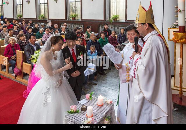 Bride And Groom At Wedding Ceremony Catholic Church Yinchuan Ningxia China