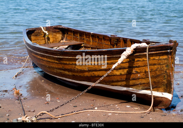 Old Wooden Rowing Boat On Beach