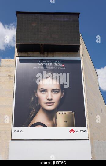Huawei Telecommunications advertising hoarding on side of building, Kutaisi, Imereti Province (Mkhare), Georgia - Stock Image