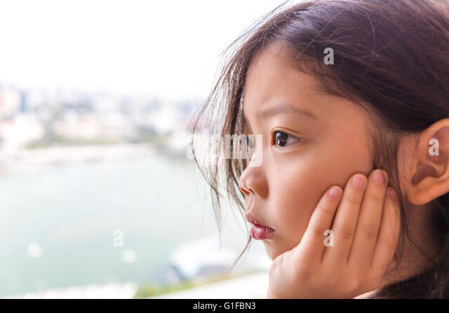 Little Girl Looking Out Of The Window Stock Photos ...