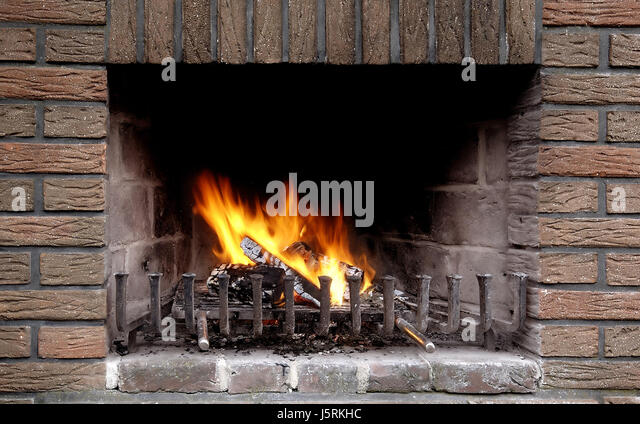 garden wall fire conflagration fireplace stove flame gardens to reside abode stock image - Steinkamin