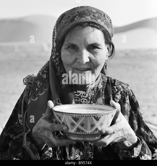 a-turkmen-woman-holds-a-tea-bowl-with-ch