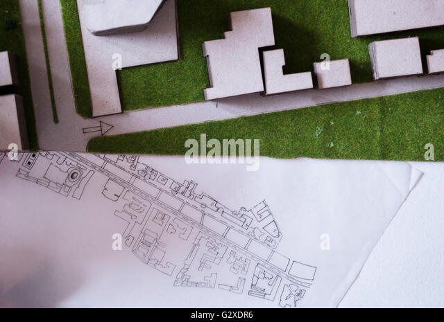 Architects drawing sketch stock photos architects drawing sketch architect working on blueprint architects workplace architectural project blueprints ruler calculator malvernweather Image collections
