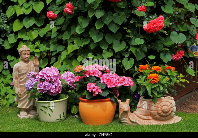 garden figures. Summer House With Flowers And Garden Figures, Germany - Stock Image Figures A