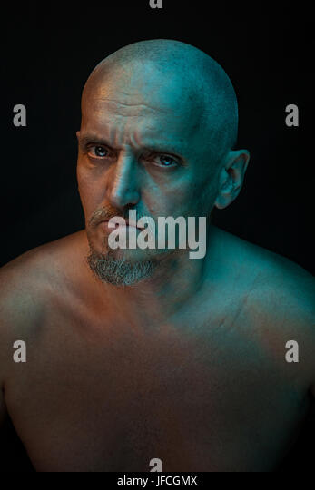 The head of a bald man's terrible. He has a mustache and beard. - Stock Image