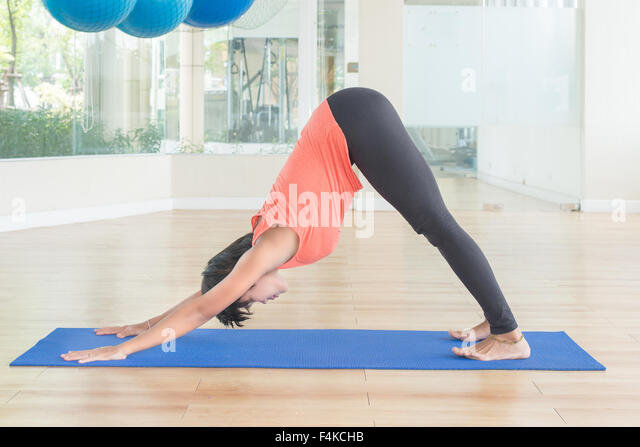 Modular Classroom Yoga ~ Downward facing dog stock photos