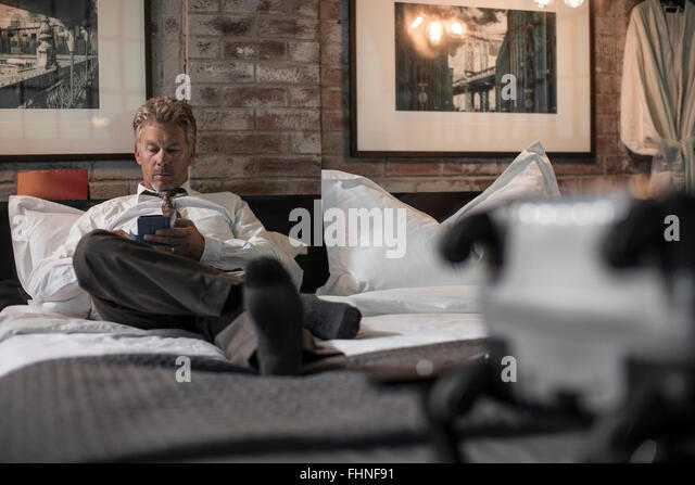 Man Sitting Alone In Hotel Room