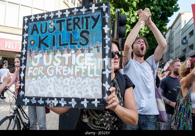 Bristol, UK, 21st June, 2017. Protesters carrying placards are pictured as they take part in a Austerity kills, - Stock Image