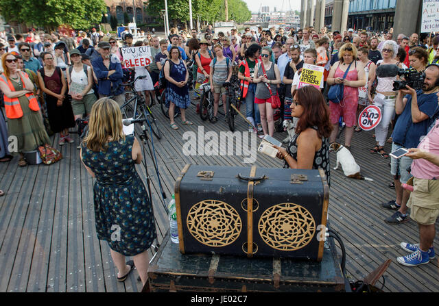 Bristol, UK, 21st June, 2017. Protesters carrying placards are pictured as they listen to speeches before taking - Stock Image