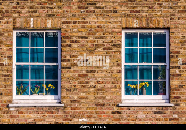 Two Windows, With Curtains Drawn, In A North London Street.   Stock Image