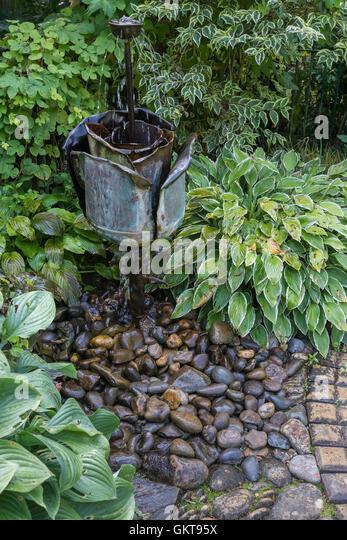 Small water feature garden stock photos small water for Small garden water features