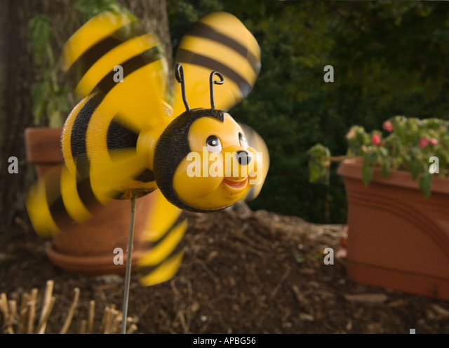 Color Horizontal Image Of A Whirligig Pinwheel Smiling Bumblebee With Wings Spinning In The Wind