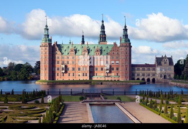 Frederiksborg Castle in Dutch Renaissance style and the Baroque Garden. Hillerød near Copenhagen. Morning sun, - Stock Image