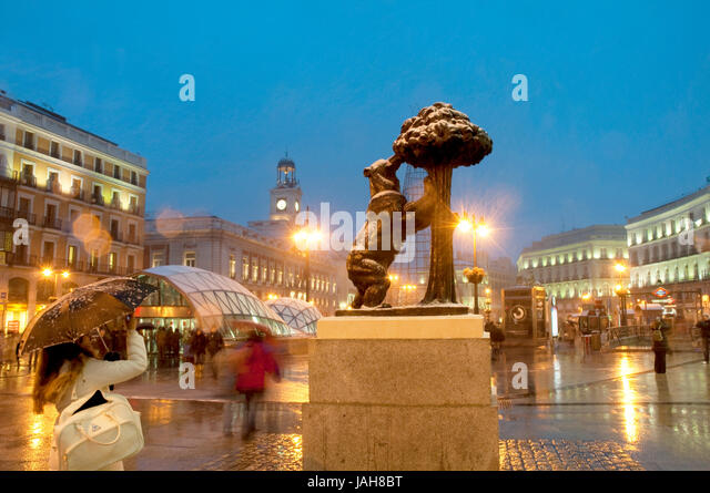 Snowing at Puerta del Sol, night view. Madrid, Spain. - Stock Image