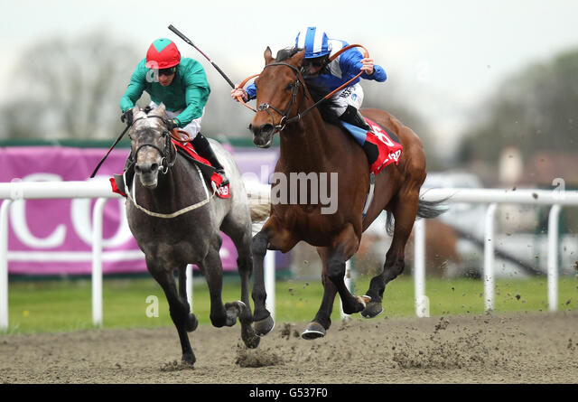 Conditions stakes at kempton park racecourse stock photos horse racing easter family fun day kempton park racecourse stock image negle Image collections