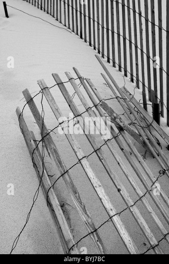 usa chatham beach cyclone fence in sand dunes along atlantic ocean at