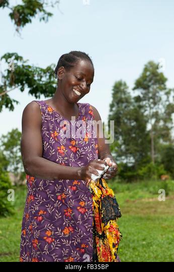 Woman Washing Clothes Africa Stock Photos & Woman Washing ...