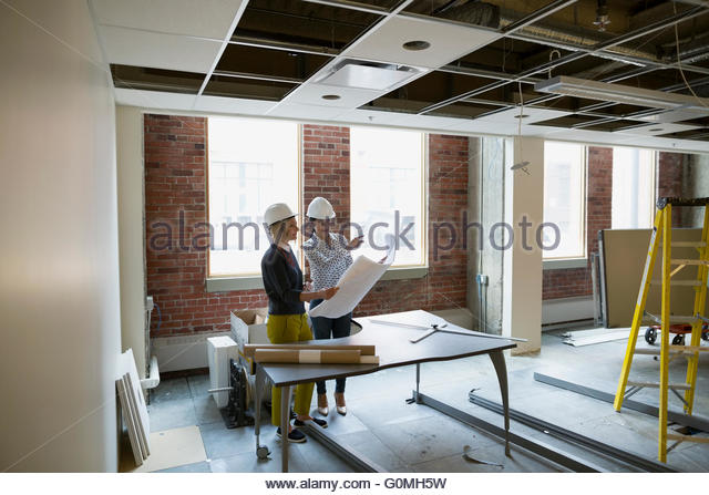 Construction site office stock photos construction site office architect and engineer discussing blueprints office construction site stock image malvernweather Gallery