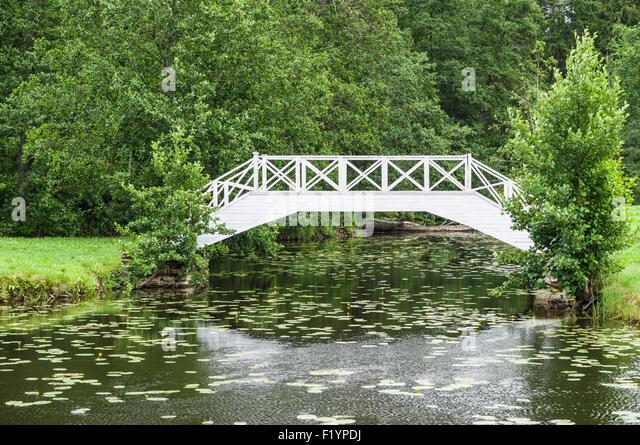 Small garden pond stock photos small garden pond stock for Garden pond bridge