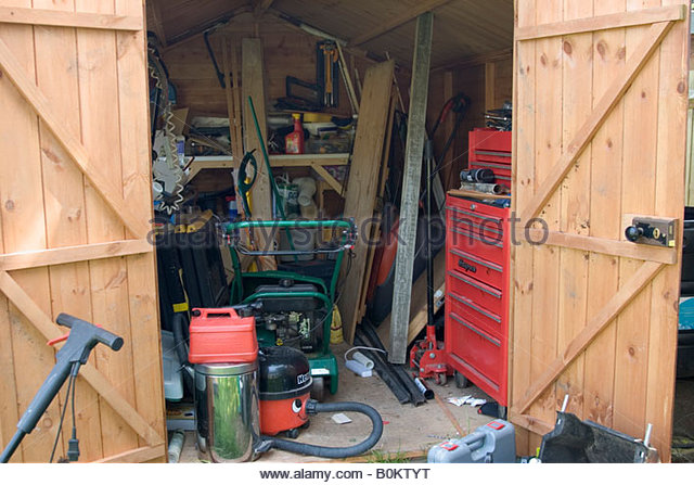 Frontal Image Of Garden Shed With Doors Open Showing Contents   Stock Image