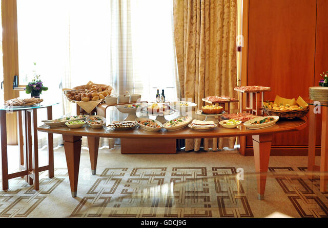 Buffet Table Laden With A Selection Of Food In A Restaurant Or Hotel With  Cold Mets