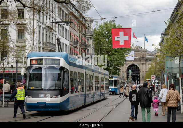 A train stops on Bahnhofstrasse, one of the most expensive and exclusive shopping avenues in the world. - Stock Image