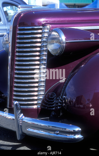 chrome front grill and headlight detail on a royal purple1938 buick mclaughlin classic car stock