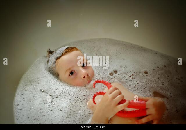 boys playing in bath stock photos boys playing in bath stock images alamy. Black Bedroom Furniture Sets. Home Design Ideas