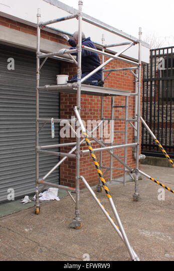 Working On Scaffolding : Wooden scaffolding on building site stock photos