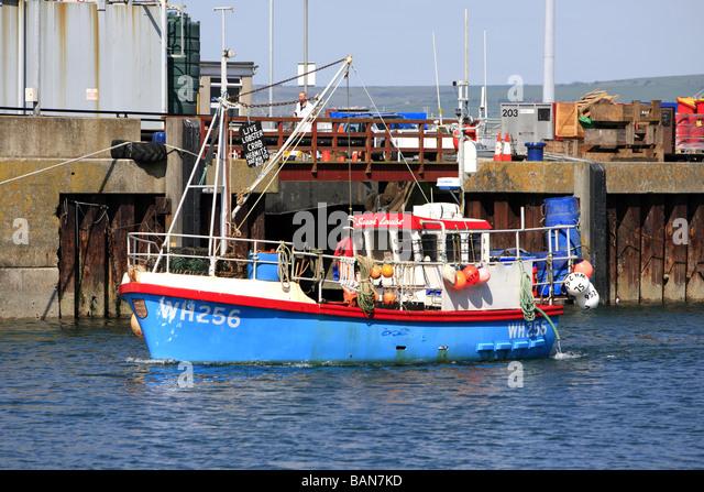Small boat crabbing stock photos small boat crabbing for Small fishing boats with motor