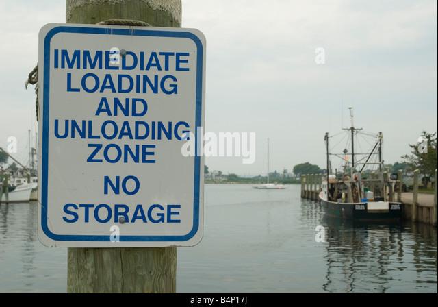 Boat Storage Signage : Unloading fish stock photos images