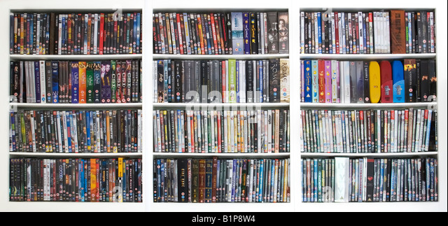 House shelf shelves full of DVD DVDs films, UK - Stock Image