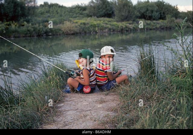 Taking kids fishing stock photos taking kids fishing for Pecos river fishing