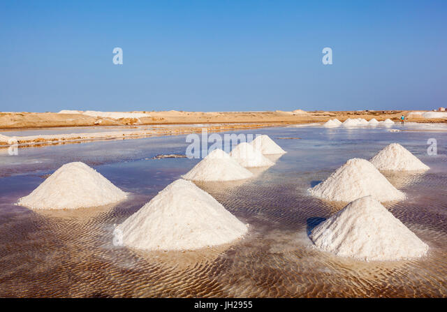Piles of salt collected from natural salt pans at Salinas, just outside Santa Maria, Sal Island, Cape Verde, Atlantic, - Stock Image