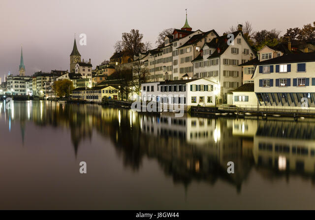 Zurich Skyline and the River Limmat in the Night, Switzerland - Stock Image
