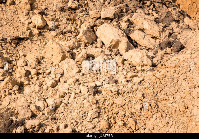 how to add sand to clay soil