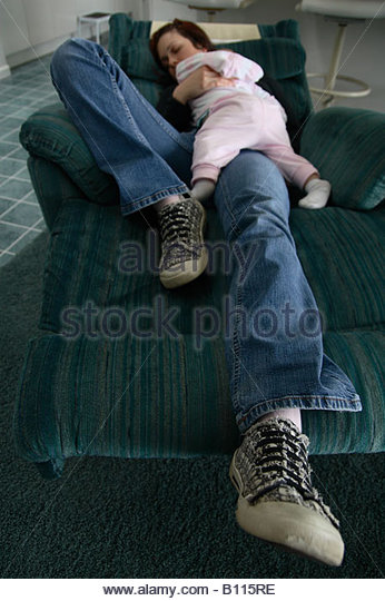 A mother and baby sleeping on a recliner. - Stock Image & Recliner Chair Woman Stock Photos u0026 Recliner Chair Woman Stock ... islam-shia.org